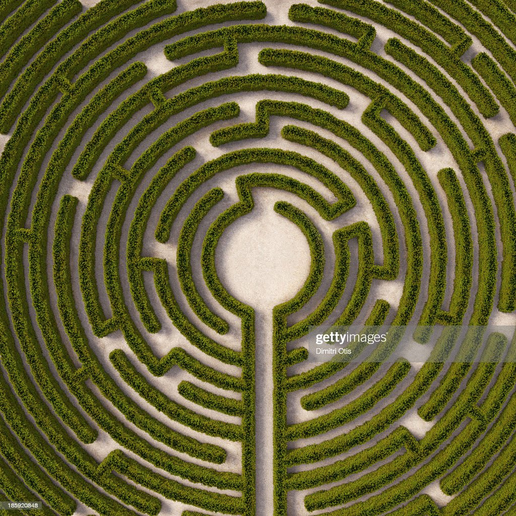 Aerial view of circular hedge maze, path to centre