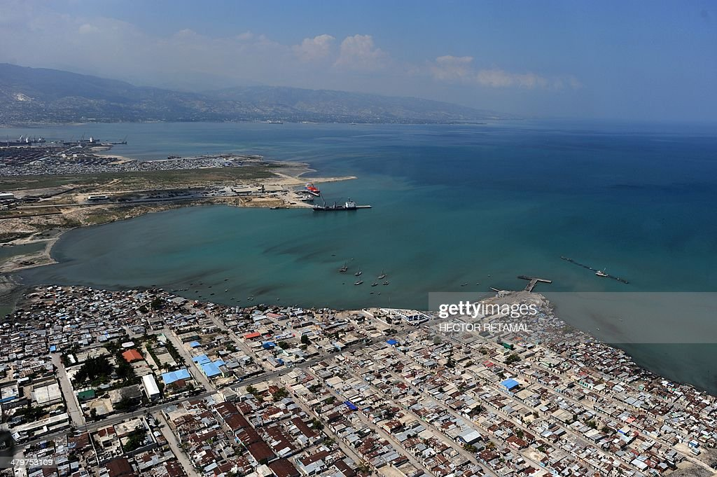 Aerial view of Cité Soleil in PortauPrince on March 20 2014 Haiti will hold legislative elections on October 26 after an agreement brokered by the...