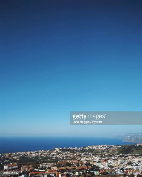 Aerial View Of Cityscape Against Clear Blue Sky