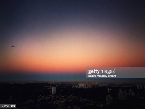 Aerial View Of Cityscape Against Sky During Sunset