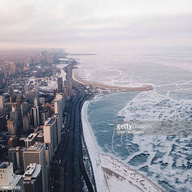 Aerial View Of Cityscape By Frozen Sea
