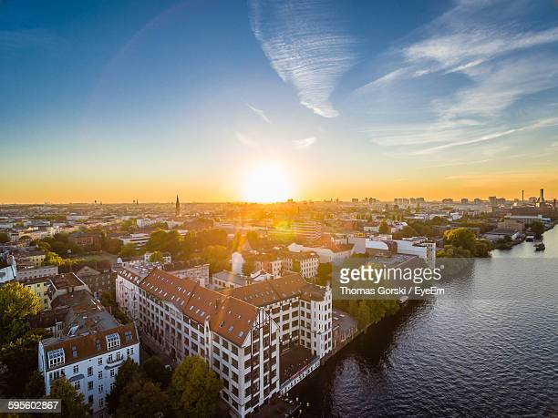 Aerial View Of Cityscape By River During Sunset