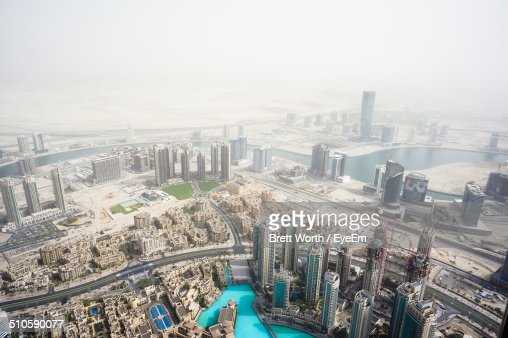 Aerial view of cityscape during sand storm
