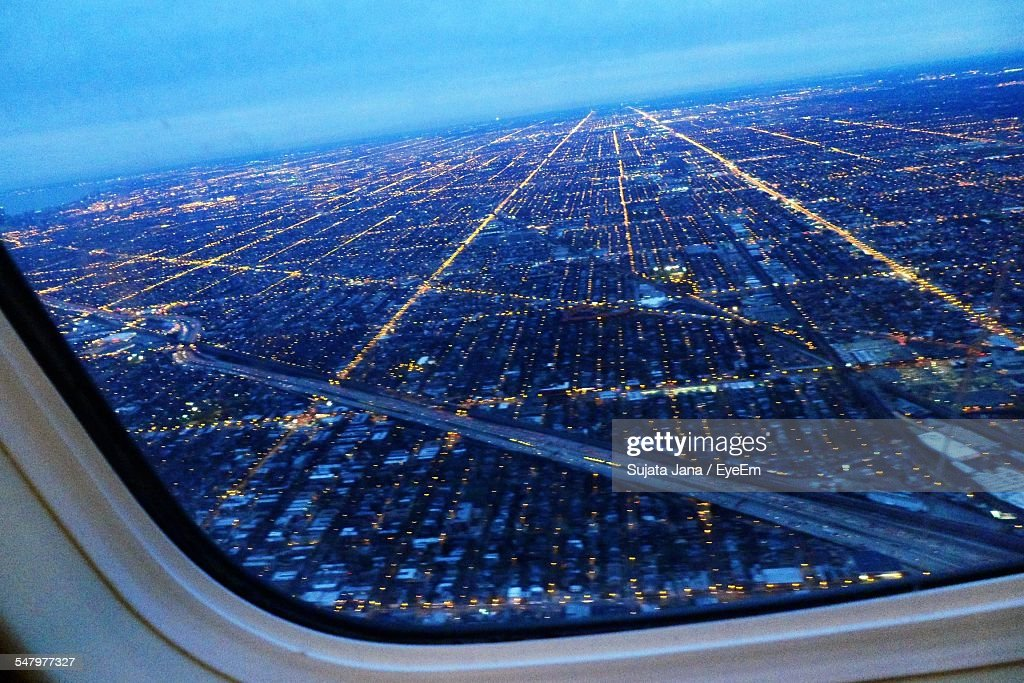 Aerial View Of Cityscape Seen Through Airplane Window : Stock Photo