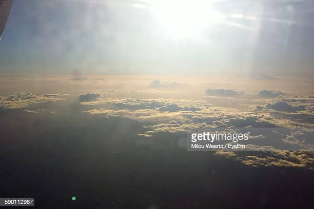 Aerial View Of Clouds Seen From Airplane Window