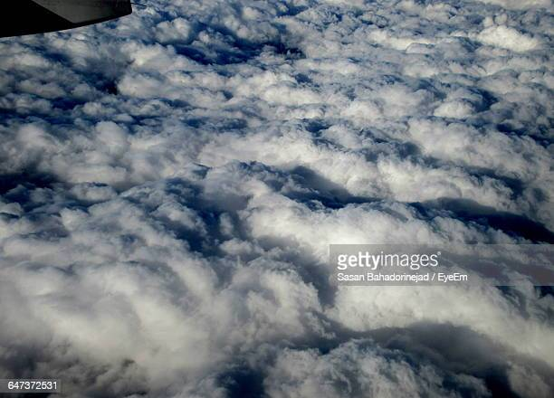 Aerial View Of Cloudscape Seen From Airplane Window