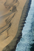 Aerial view of coastline and dunes, Namib Desert, Namibia