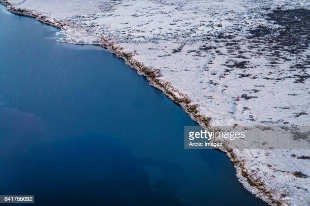 Aerial view of coastline and snow covered lava fields, Iceland