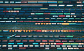 Cargo trains close-up. Aerial view of colorful freight trains on the railway station. Wagons with goods on railroad. Heavy industry. Industrial conceptual scene with trains. Top view from flying drone