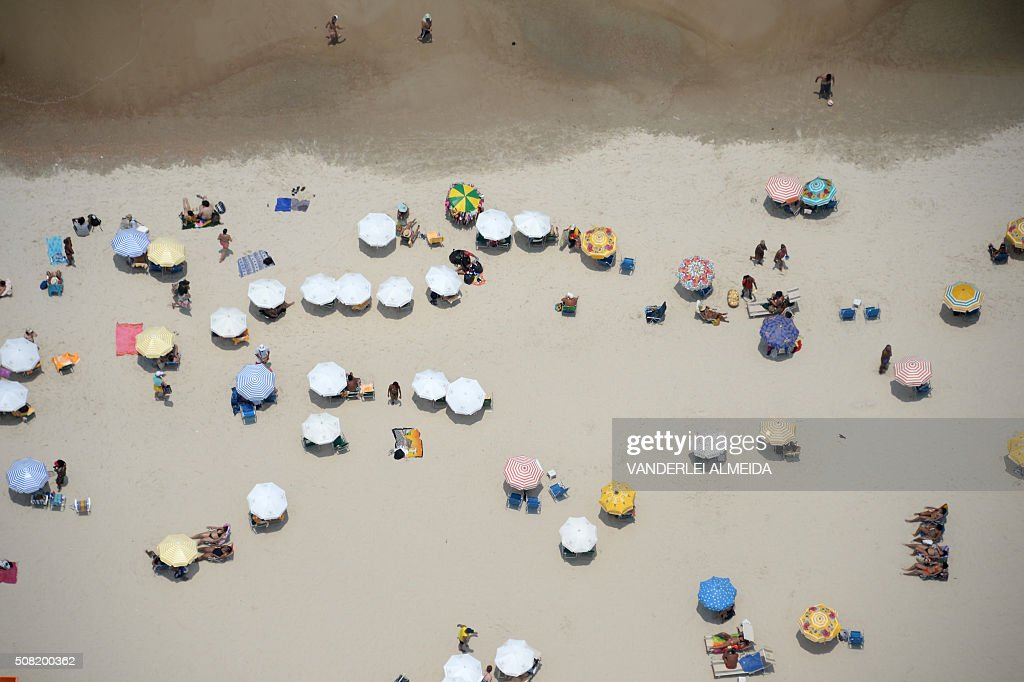 TOPSHOT Aerial view of Copacabana Beach in Rio de Janeiro Brazil on February 3 2016 With temperatures reaching the 3640 degrees Celsius tourists and...