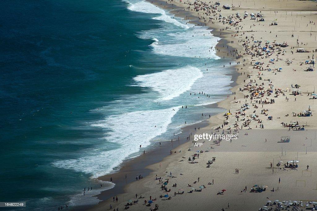 Aerial view of Copacabana beach in Rio de Janerio, Brazil, on March 28, 2013. AFP PHOTO/Yasuyoshi CHIBA