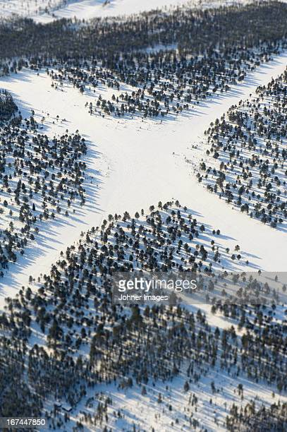 Aerial view of crossroads covered by snow at winter