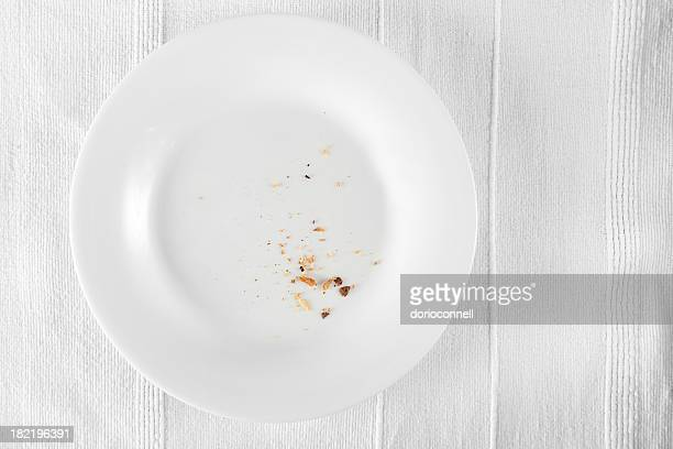 Aerial view of crumbs on a white dinner plate
