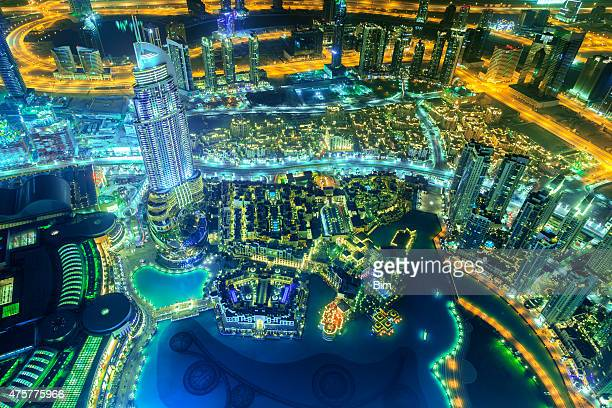 Aerial View of Downtown Dubai Illuminated at Night