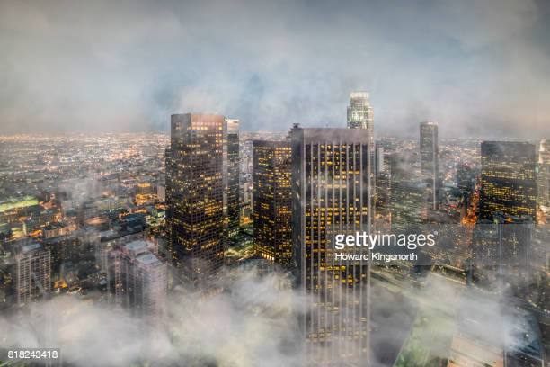 Aerial view of LA downtown with misty sky at sunset