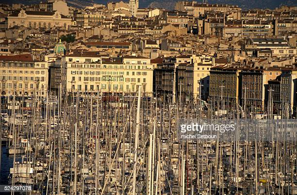 Aerial view of dozens of boats crammed into the 'Old Port' against the backdrop of Saint Ferreol church from the 'Les Trois Forts' restaurant located...