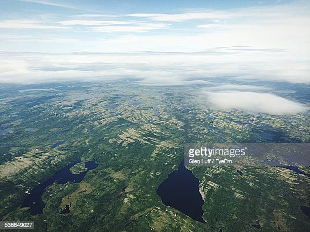 Aerial View Of Dramatic Landscape Against Cloudy Sky
