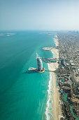 Aerial view of Dubai city beach and coast line on a clear sunny day.