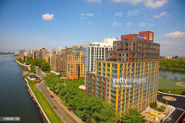 Aerial view of East River and new residential buildings on Roosevelt Island, looking north, from Roosevelt Island Tram, New York City