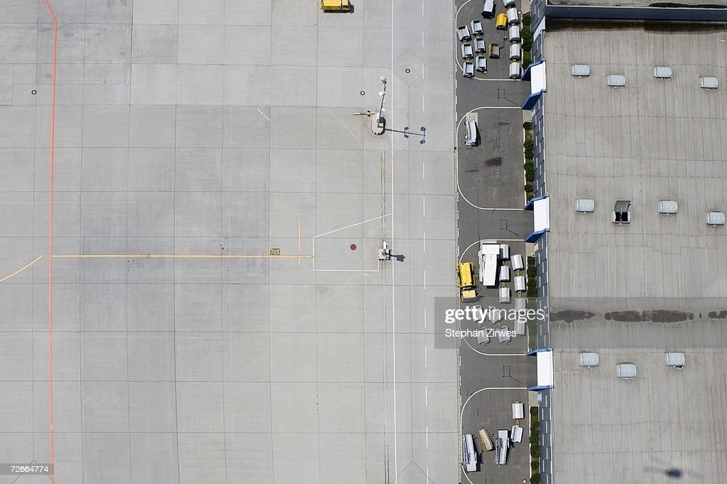 Aerial view of empty airport tarmac and luggage carts