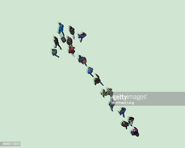Aerial View of eople walking in shape of an arrow