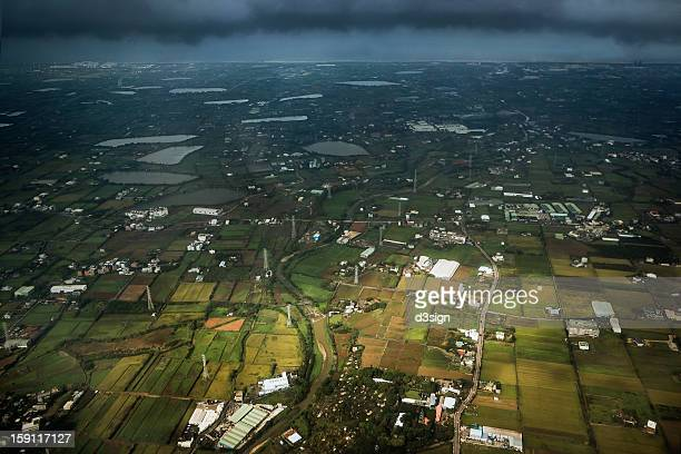 Aerial view of farmland and village in rural area