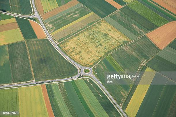 Aerial View of Farmland, Roads and Traffic Circle
