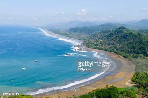 Aerial view of fishing boats and coastline. Dominical, Costa Rica