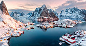 Aerial view of fishing village in surrounded mountain on winter season at Reine, Lofoten islands, Norway