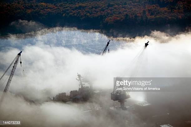 Aerial view of fog over Bath Iron Works and Kennebec River in Maine Bath Iron Works is a leader in surface combatant design and construction with a...