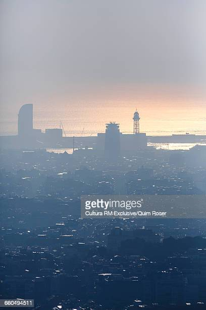 Aerial view of foggy Barcelona city scape, Spain