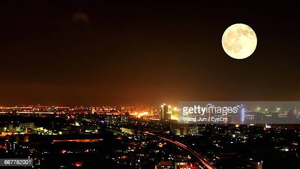 Aerial View Of Full Moon And Cityscape