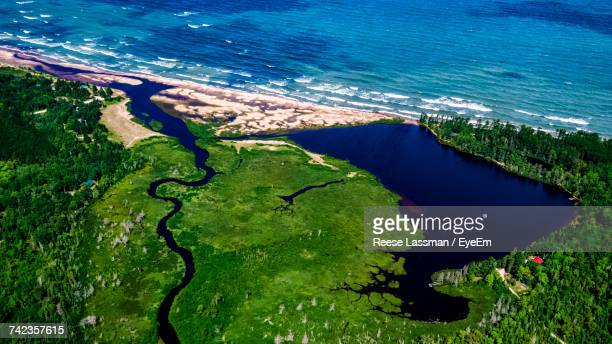 Aerial View Of Green Landscape By Sea