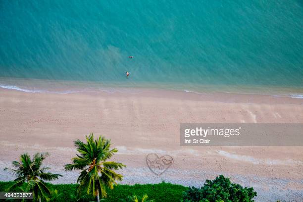 Aerial view of heart-shape on tropical beach