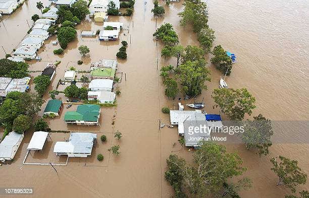 Aerial view of homes surrounded by flood waters on January 6 2011 in Rockhampton Australia Floodwaters peaked at 92 metres yesterday in the central...