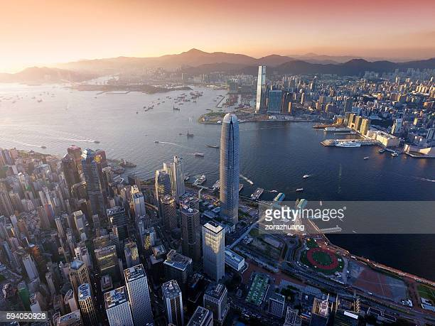 Aerial view of Hong Kong city, Victoria harbour in sunset