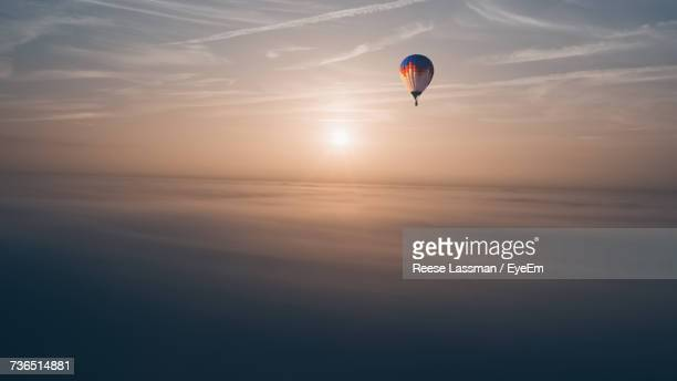 Aerial View Of Hot Air Balloon Against Orange Sky During Sunset