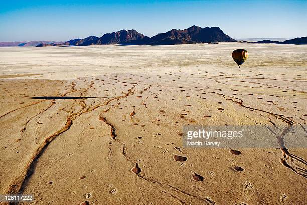 Aerial view of hot air balloon over Namib desert. The circular patches (aka fairy circles), are derived from any vegetation & surrounded by tall grass. Cause of this phenomenon is unknown. Namib Naukluft NP, Namibia. (PR: Property released)