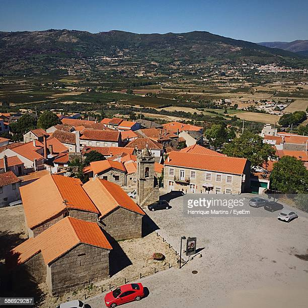 Aerial View Of Houses Against Mountains