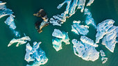 Aerial view of icebergs floating in Jokulsarlon Lagoon near the southern coast of Iceland.