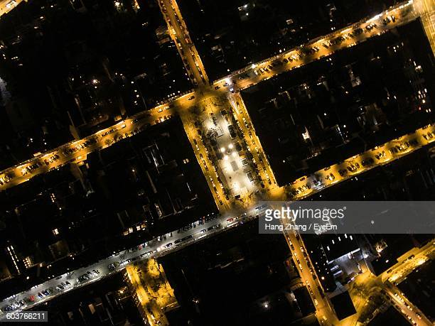 Aerial View Of Illuminated City Streets At Night