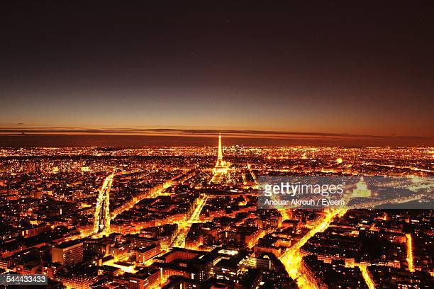 Aerial View Of Illuminated City With Eiffel Tower Against Clear Sky At Night