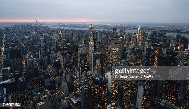 Aerial View Of Illuminated Cityscape At Dusk