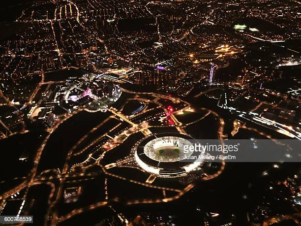 Aerial View Of Illuminated Olympic Stadium And Cityscape At Night