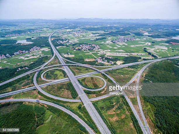 Aerial view of intersecting highways near trees