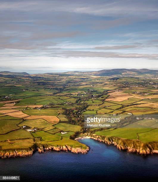 Aerial view of Isle of Man coastline and fields