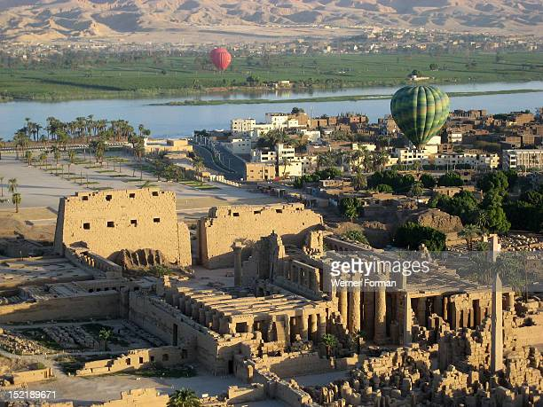 Aerial view of Karnak the river Nile and the west bank Theban Necropolis containing the Valley of the Kings and the Valley of the Kings in the...