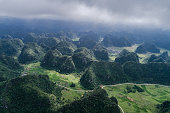 Aerial view of Karst mountains and rice fields