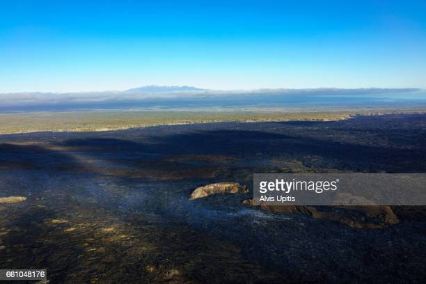 Aerial view of Kileau Volcano lava devastation near Hilo, Hawaii.
