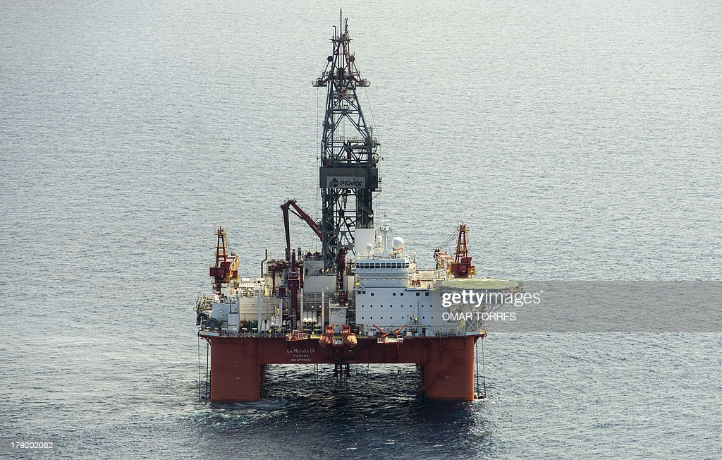 Aerial view of La Muralla IV exploration oil rig, operated by Mexican company 'Grupo R' and working for Mexico's state-owned oil company PEMEX, in the Gulf of Mexico on August 30, 2013. The semisubmersible platform is able to drill to a depth of 10.000 meters in an enviroment such as the Gulf of Mexico.